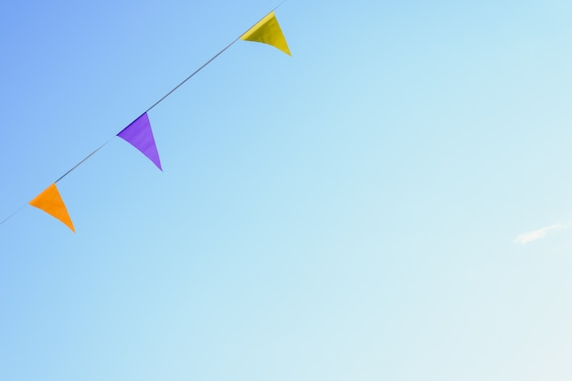 Colorful pennants with sky background to place text