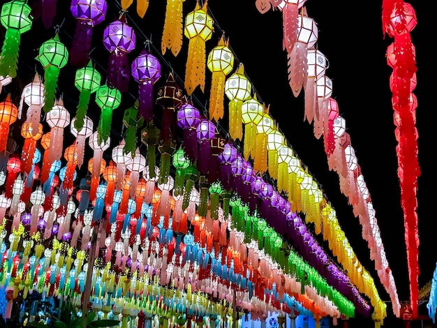 Colorful perspective and look up view of thai lanna style lanterns to hang in front of the temple on night time in loy kratong festival.