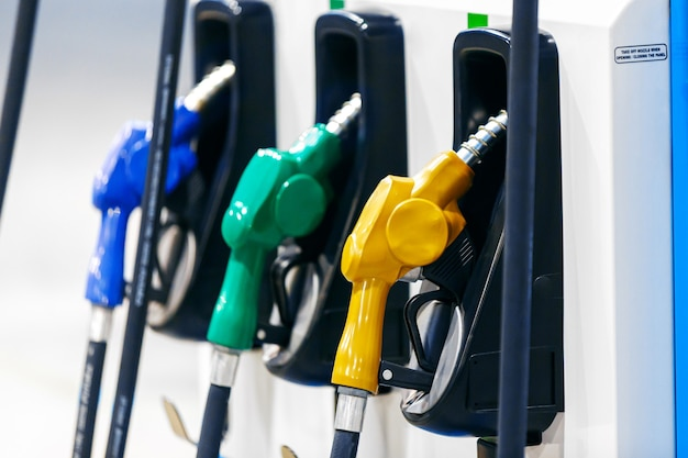 Colorful petrol pump filling nozzles in gas station