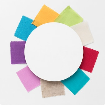 Colorful pieces of cloths arrangement with a white circle centered