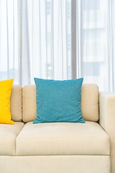 Colorful pillows on beige sofa