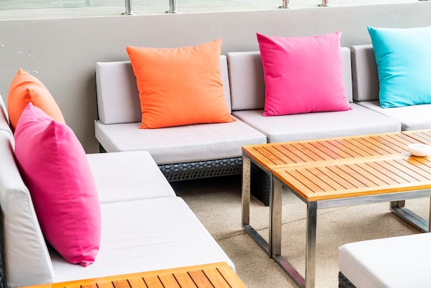 Colorful pillows on sofa in outdoor patio