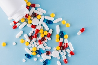 Colorful pills and plastic bottle