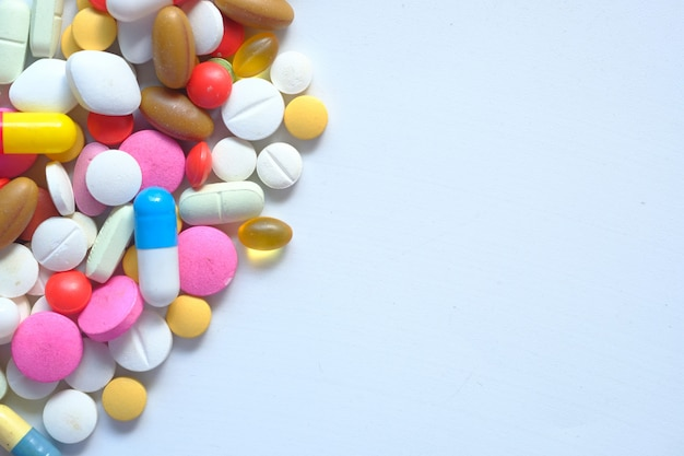 Colorful pills on white background with copy space
