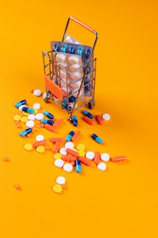 Colorful pills with tiny metallic container