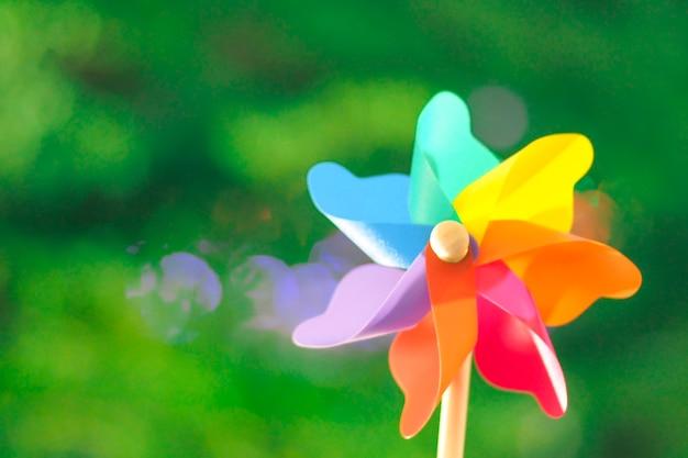 Colorful pinwheel bokeh background of summer