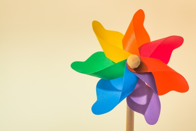 Colorful pinwheel toy on white background