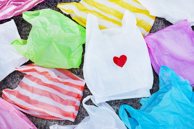 Colorful plastic bags on cement floor
