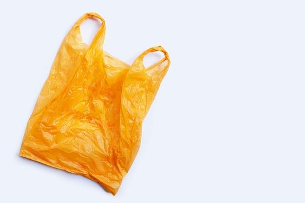 Красочные пластиковые пакеты на белом