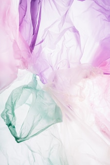 Colorful plastic bags on white background