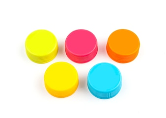 Colorful Plastic bottle caps on white background