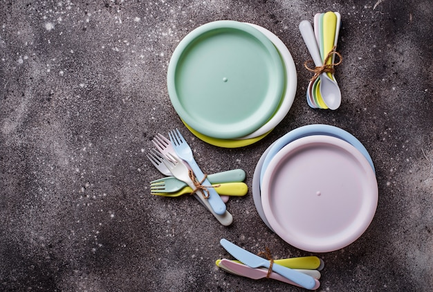 Colorful plastic dishes for summer picnic