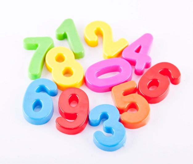 Colorful plastic number on white background