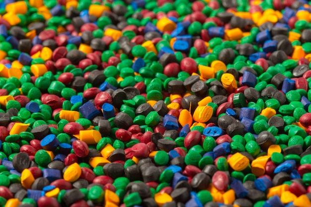 Colorful plastic polymer granules background