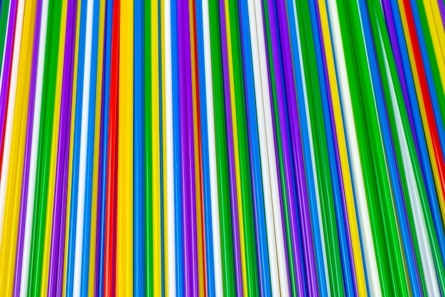 Colorful plastic tubules background. top view.