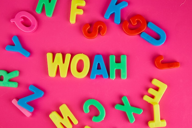 Colorful plastic words isolated in pink background