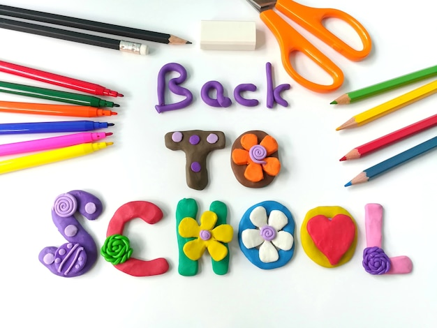 Colorful plasticine clay handmade are back to school text and stationery
