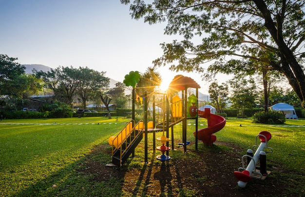 Colorful playground and sunrise  on yard in the park