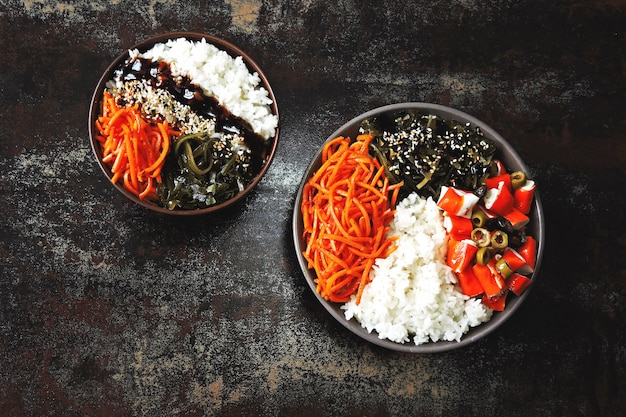 Colorful poke a bowl with seaweed and crab meat.