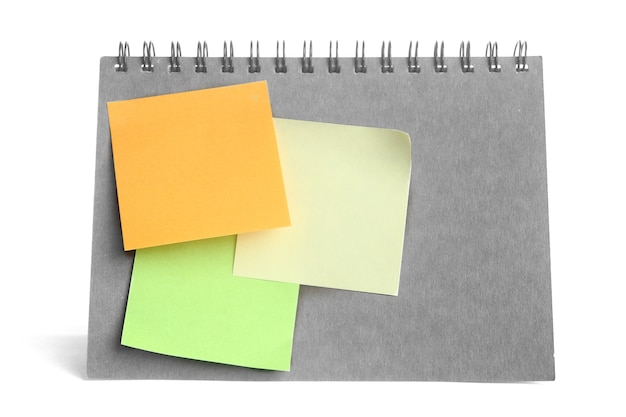 Colorful post it paste on notebook on white background