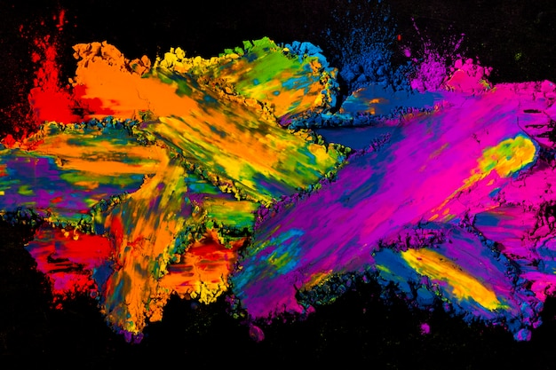 Colorful powder explosion on black background