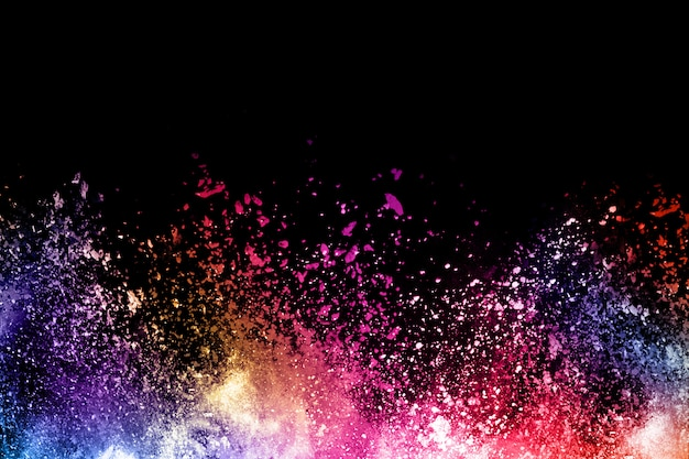 Colorful powder explosion on black background.
