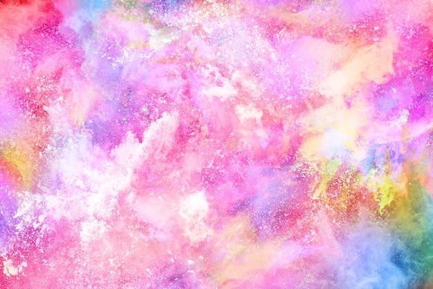 白い背景の上のカラフルな粉塵爆発