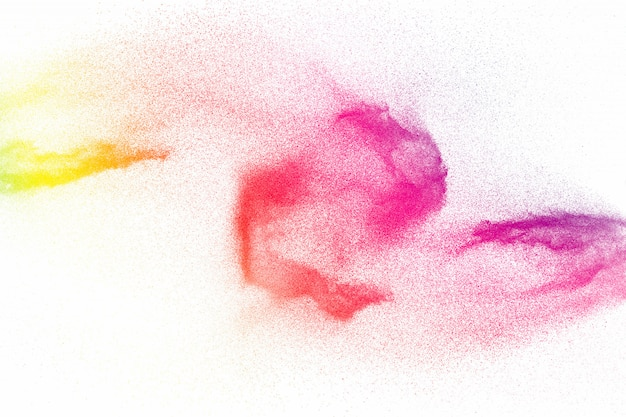 Colorful powder explosion on white surface.