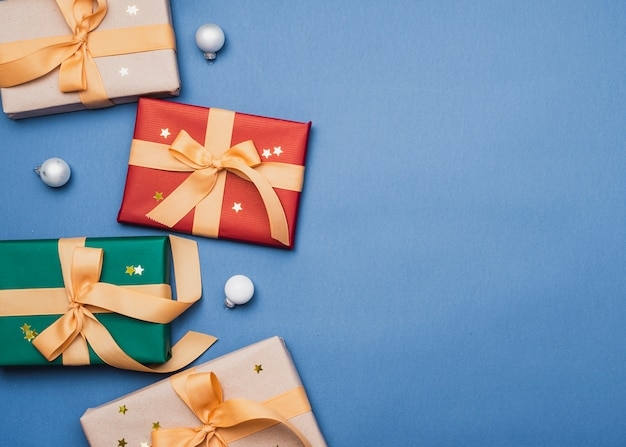 Colorful presents with ribbon on blue background