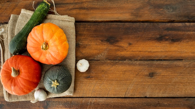 Colorful pumpkins on cloth with copy space