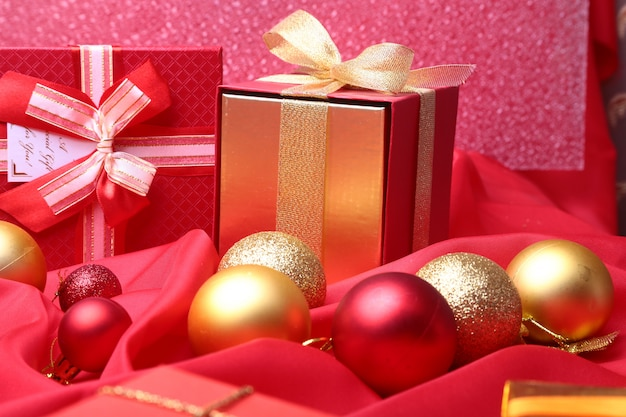 Colorful red gifts with christmas balls isolated on red
