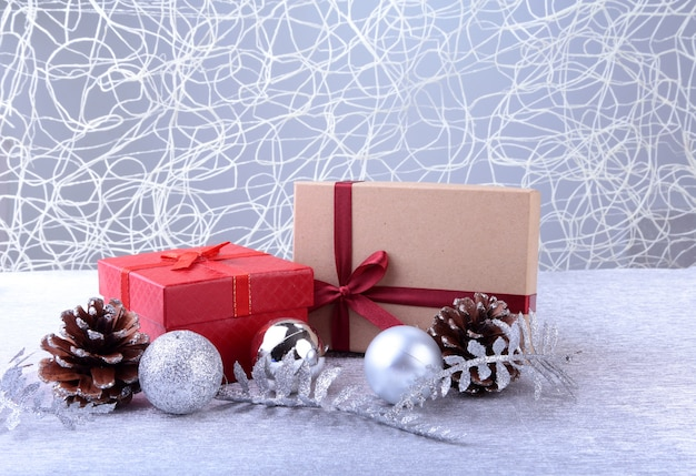 Colorful red gifts with christmas balls isolated on silver
