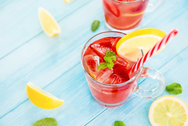 Colorful refreshing strawberry lemonade juice drinks for summer