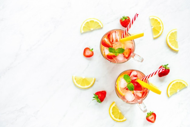 Colorful refreshing strawberry lemonade juice drinks for summer,