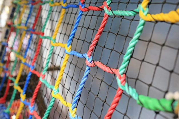 Colorful rope net tied for climb. indoors playground.