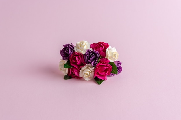 Colorful rose flowers decoration on pastel pink background
