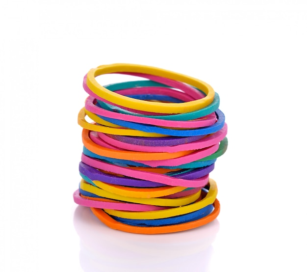 Colorful rubber bands on white