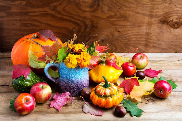 Colorful rustic thanksgiving decoration with apples and pumpkins