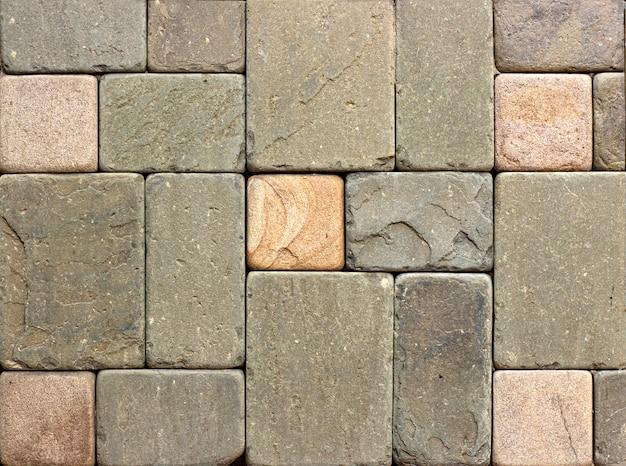 カラフルな砂岩壁石のテクスチャタイル背景パッチワーク、茶色