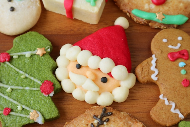 Colorful santa and many of christmas cookies