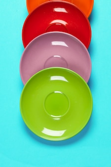 Colorful saucers on a vibrant bright background