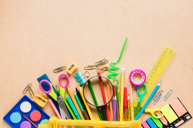 Colorful school equipment on plain background