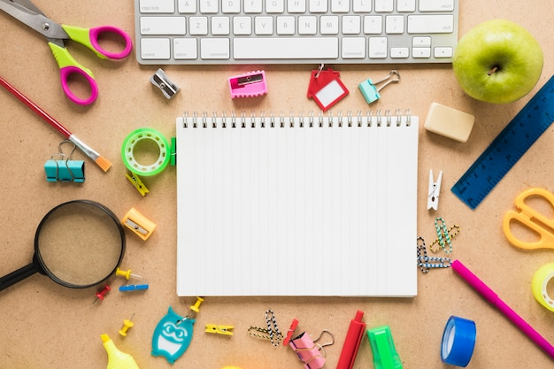 Colorful school and office supplies on plain background