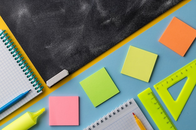 Colorful school stationery and chalkboard