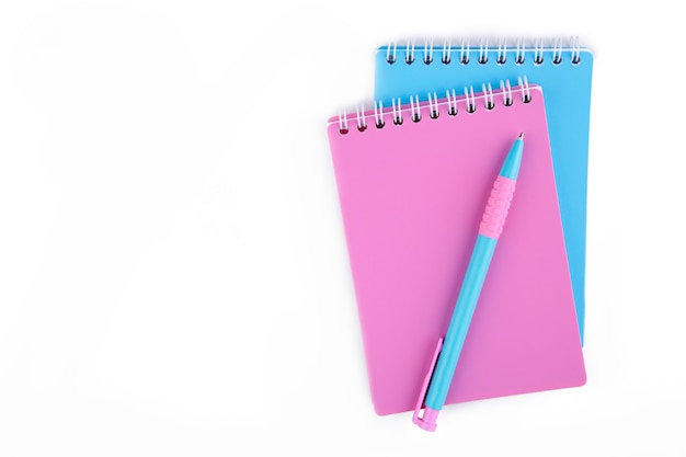 Colorful school supplies isolated on white