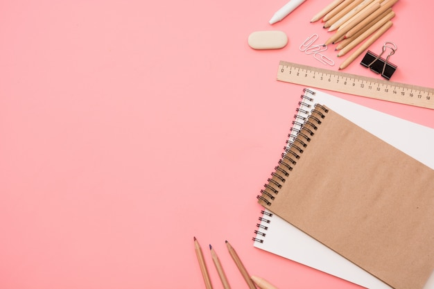 Colorful school supplies on pastel pink. top view, flat lay.