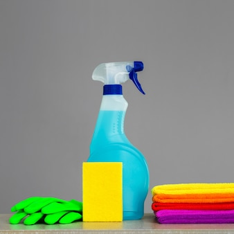 Colorful set of tools for cleaning the house on neutral