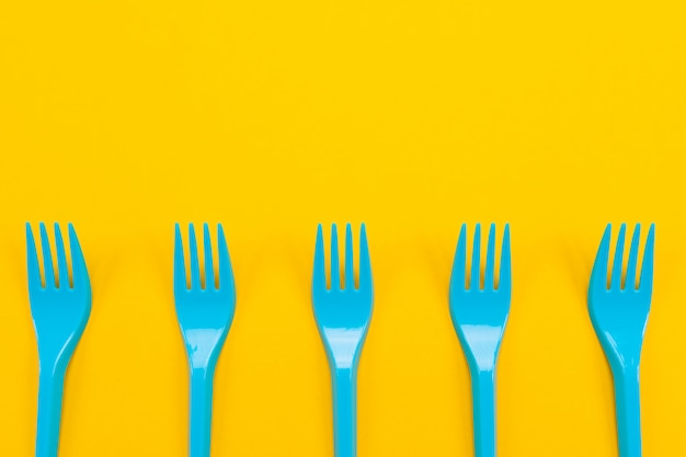 Colorful set of vibrant forks and knife isolated on black