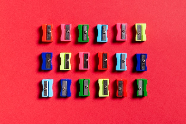 Colorful sharpeners on red background