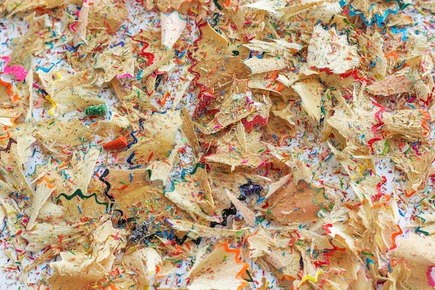 Colorful shavings from pencils, background.